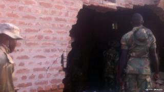 A hole made by a jailbreak in the north-eastern Nigerian town of Bama (May 2013)
