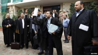 Libyan lawyers celebrate after the court invalidated the country's parliament, outside the Supreme Court in Tripoli, November 6, 2014