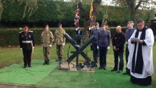 The unveiling of the sculpture