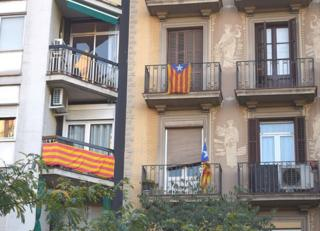 Catalan flags draped on apartment block in Barcelona, 6 Nov 14