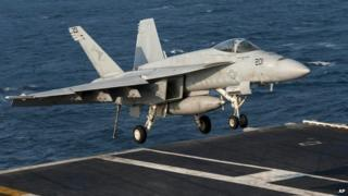 A US Navy aircraft lands on the USS Carl Vinson in the Persian Gulf - 31 October 2014