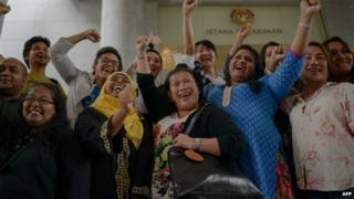 Transgender activists celebrate outside the court of appeals in Putrajaya on November 7, 2014