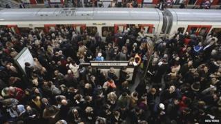 Passengers board a train in Earls Court