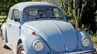 President Jose Mujica flashes a thumbs up as he and his wife, Sen. Lucia Topolansky, ride away from their home on the outskirts of Montevideo - 2 May 2014