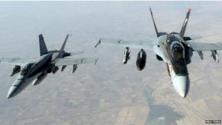 U.S. Navy F-18E Super Hornet jets leave to support military operations against ISIL after receiving fuel from a KC-135 Stratotanker over Iraq 11 August 2014