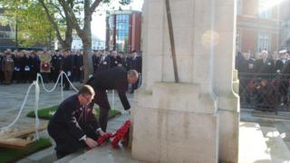 Swindon MPs Justin Tomlinson and Robert Buckland laying wreaths
