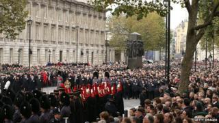 Crowds, armed forces personnel and dignitaries at the Cenotaph on Remembrance Sunday