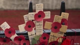 Crosses placed on fence outside Tower of London poppy artwork