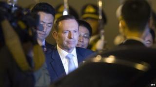 Australian Prime Minister Tony Abbott arrives at the Beijing International Airport - 9 November 2014