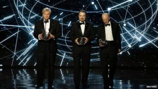 Fundamental Physics winners Brian Schmidt, Adam Riess, and Saul Perlmutter speak on stage during the 2nd annual Breakthrough Prize Awards
