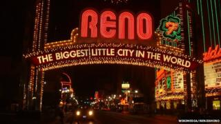 """An illuminated sign reading """"Reno: The biggest little city in the world"""""""
