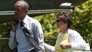 President Obama walks next to his advisor Valerie Jarrett.