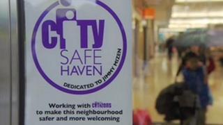 City Safe Haven poster on a shop