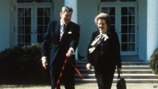 British Prime Minister Margaret Thatcher - carrying handbag - walking with US President Ronald Reagan - walking dog - outside White House.