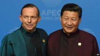 Tony Abbott poses with Chinese President Xi Jinping at the Apec summit banquet in Beijing - 10 November 2014