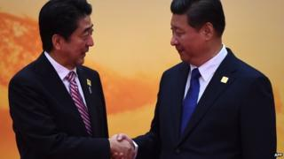 Papers see the meeting between President Xi Jinping (R) and PM Shinzo Abe a step in the right direction