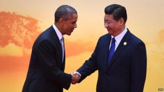 US President Barack Obama (L) shakes hands with China's President Xi Jinping as he arrives for the Asia-Pacific Economic Cooperation (APEC) leaders meeting at Yanqi Lake, north of Beijing on 11 November 2014.
