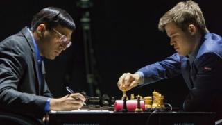 Norway's Magnus Carlsen plays against India's former world champion Vishwanathan Anand