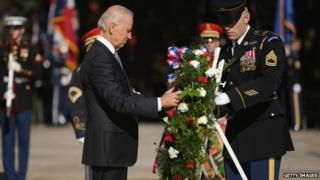 US Vice President Joe Biden lays a wreath during a ceremony at the Tomb of the Unknowns during Veterans Day observations at Arlington National Cemetery November 11, 2014 in Arlington, Virginia.