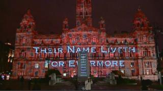 The projections on the side of the City Chambers read: Their Name Liveth for Evermore