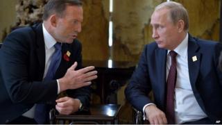 Prime Minister Tony Abbott talks with Russian President Vladimir Putin on the sidelines of the Apec summit in Beijing - 11 November 2014