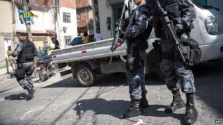 Police patrolling a Rio de Janeiro slum