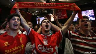 Liverpool supporters at Sydney's Cheers Bar sing in support of their side, playing 17,000 miles away - 9 November 2014