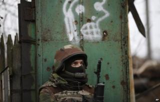 A Ukrainian soldier stands guard near the village of Peski, Donetsk region, 11 November