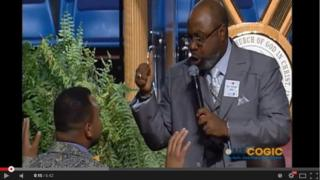 A preacher talking to a member of his congregation