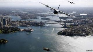 Two Royal Australian Air Force Hercules aircraft fly above the Sydney Opera House and Sydney Harbour Bridge during a display, in this handout picture released by the Australian Defence Force on 10 September, 2014