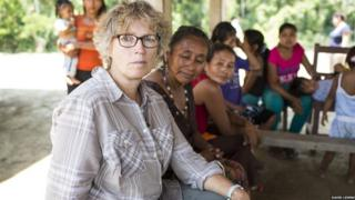 Liz Crew meeting Bolivian community to talk about how flooding affects them