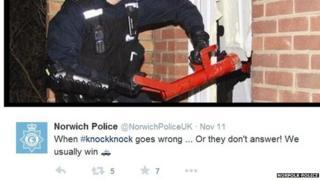 Unknown officer uses battering ram to break down door