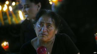 A woman prays at a temple outside Guatemala City