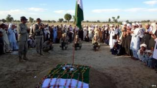 Relatives and soldiers attend the funeral ceremony of Lance Naik Habib, a Pakistani Army soldier who was killed during clashes with militants in the Spin Qamar area of Khyber in Pakistan. 10 November 2014