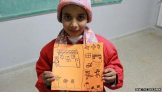 Siham, 10, with a picture of her house