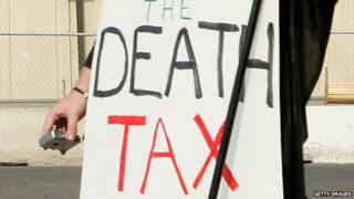 A member of College Republicans National Committee dresses as Grim Reaper as he marches on Capitol Hill to call on the Senate to eliminate the death tax June 8, 2006 in Washington, DC