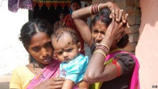 Nandini (left) holding Rekha's baby, and Anjani (right)