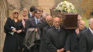 Acker Bilk's coffin is carried out of church