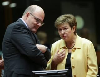 EU Budget and Human Resources Commissioner Kristalina Georgieva (R) chats with German finance official Steffen Kampeter in Brussels, 14 November