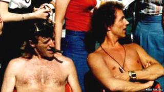 Jimmy Savile and Ray Teret together, sitting bare-chested - date and place unkown
