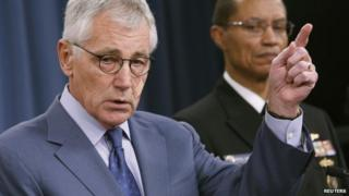 US Secretary of Defense Chuck Hagel (L) speaks at a press conference in Washington DC 14 November 2014