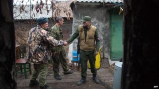 Pro-Russian gunmen greet each other in Donetsk on 13 November 2014