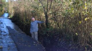 Mickey Larkin standing in trench on Ballard Road