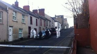 Forensic investigators arrive at the scene of the house fire on Upper Bennett Street