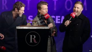 Gary Barlow (right), Howard Donald (left) and Mark Owen as the Regent Street Christmas lights were switched on
