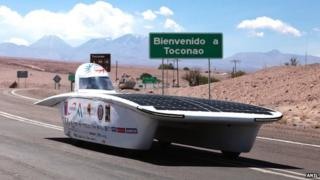 Solar-powered car in Chile desert with mountains in background, 14 November 2014