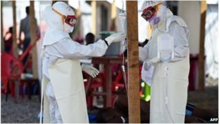 Red Cross workers at an Ebola clinic in Sierra Leone (15 Nov 2014)