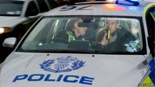 Police breathalyse drink-driver.