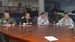 Colombian President Juan Manuel Santos (R) attends a meeting accompanied by Defence Minister Juan Carlos Pinzon and head military commanders in Choco, November 16, 2014