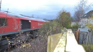 train passing gardens